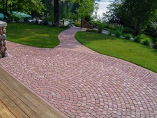 Radial red brick pattern patio with matching walkway