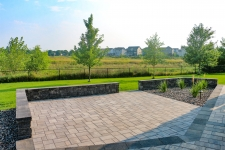 paver patio with sitting walls and plantings