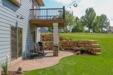 tiered flagstone retaining walls and a patio