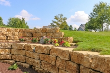 Tiered flagstone retaining walls