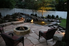 flagstone patio with water feature and lighting