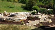 Above ground raised fire pit with garden and retaining wall
