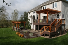 Brown second story deck with stained wood pergola and railing