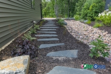stone path with mulch and rock near side of house