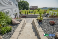 stepping stone path to retaining wall