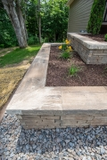 Tiered stone retaining wall with mulch