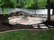 waterfeature near flagstone firepit